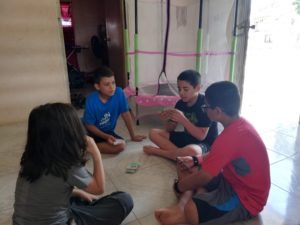 Kids playing Monopoly deal
