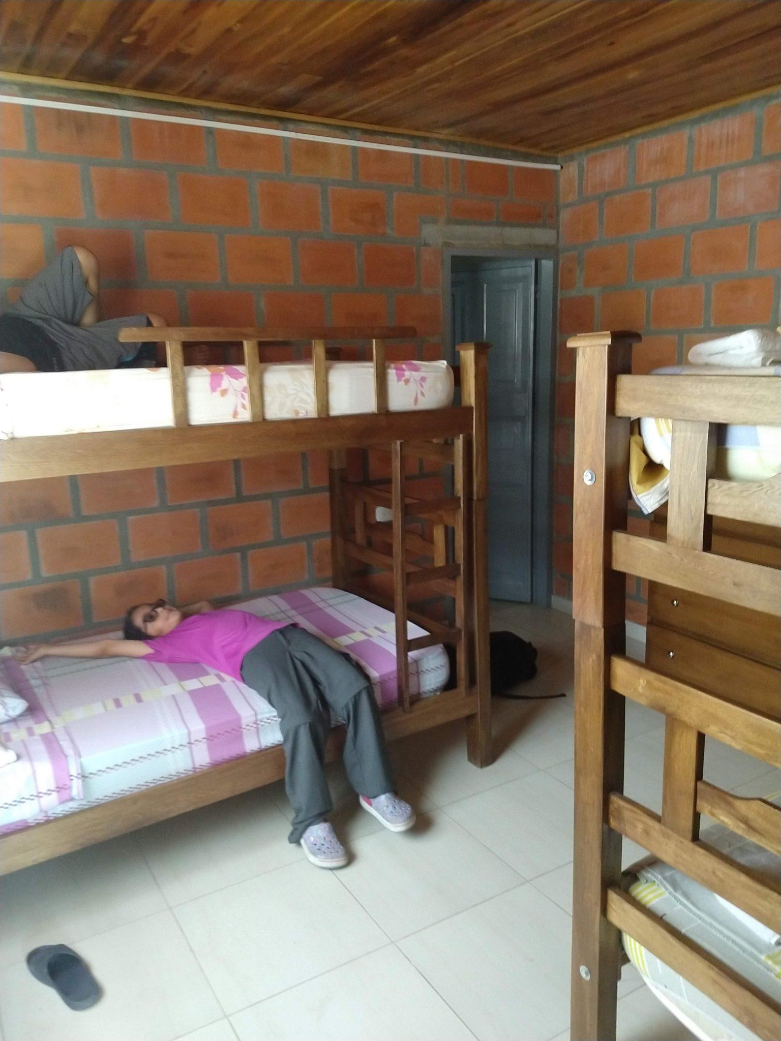 Daniela on a bed at Cabanas el Descanso y Zamukia