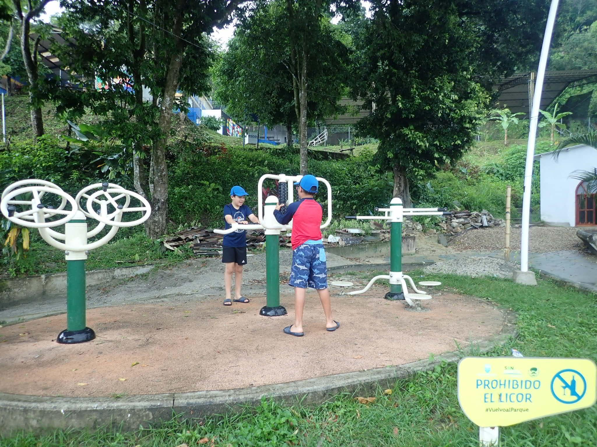 Mateo and Marco at the workout playground in Minca, Colombia