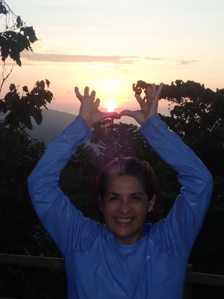 Charo holding the sun in Minca, Colombia