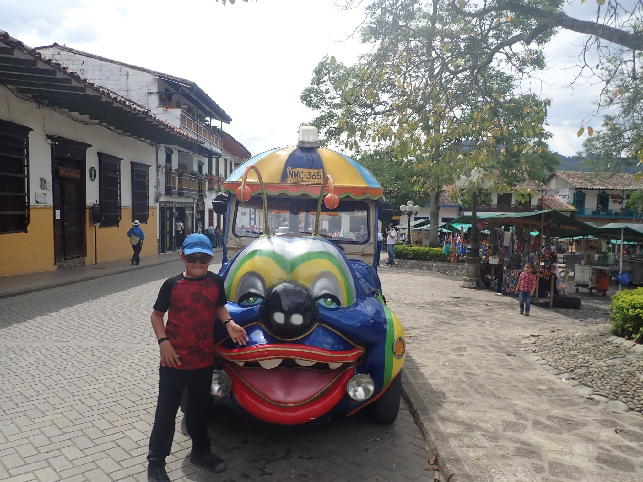 Mateo in front of a caterpillar train Jardin, Colombia